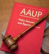 wooden gavel laying across the AAUP's Policy Documents and Reports, a book with a red cover and gold lettering with gray book and wooden desk beneath